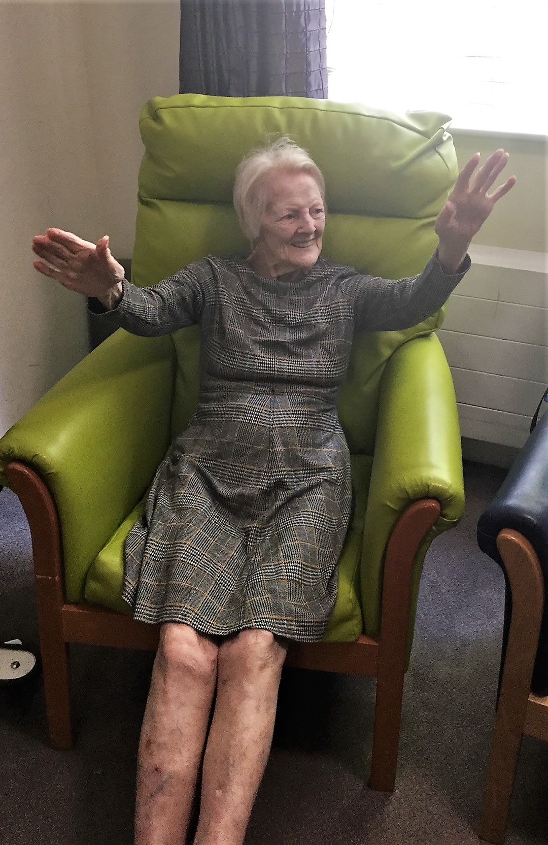 Lady doing armchair exercises